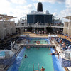 """There's a glimpse of the """"Solstice's"""" Pool area... a very nice design compared to a typical ship as it had huge Cabanas on both decks providing lots of shade for those hot, hot days!"""