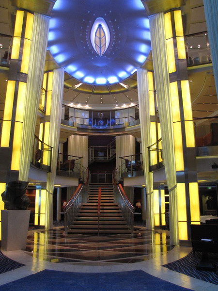 "As we were just in St. Maarten last week while on Norwegian Epic, we figured today is the perfect time to show you around the rest of the ""Solstice""... there's a glimpse of the 3 Story Atrium... Beautiful!!"