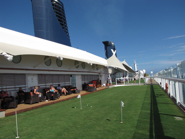 """One of the coolest new & unique features on Solstice is the real grass up in the """"Lawn Club""""!  Besides lawn bowling, ring toss, etc. you can do some putting on the grass while at Sea."""