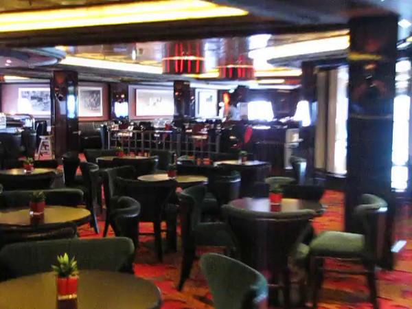 "Here's some Video where we show you the Beautiful ""Cagney's"" and ""Moderno"" venues and the ""Manhattan"" Dining Room & Supper Club that they both look down in to... very nice area of the Ship!!"