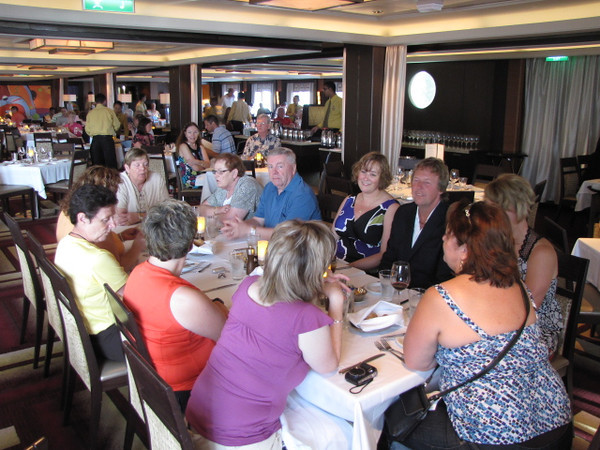 """There's the rest of the Gang in the """"Manhattan"""" Dining Room enjoying our first Evening meal onboard... 18 people is too many to fit into one table but no worries, that had us right next door to each other. :-)"""