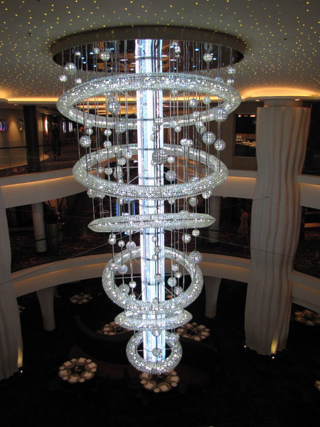 Many of the Cruise Ships sailing the Seven Seas have a chandelier in their Atrium but none like Epic's... it's the largest LED chandelier at Sea... it's Huge (21 feet high, 11 feet in diameter & weighs 2 tons), it changes colours... it's pretty awesome!! :-)