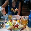"There's Nancy digging in to our 1st meal on the ""Epic""... as we stayed in a Suite on this Cruise we had access to the Private ""Epic Club"" up in the Exclusive ""Courtyard"" (now known as ""The Haven"")... as you can see by our Prawn Cocktails, everything was 1st Class up there!"