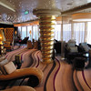 "As we mentioned earlier, when staying in a Suite on Epic you have access to the Suite's ""Ship within a Ship"" area.  Lots of Private areas up there to enjoy your Cruise and get away from the crowd.  Here's the ""Epic Lounge""... the Suite guest's Private Bar."