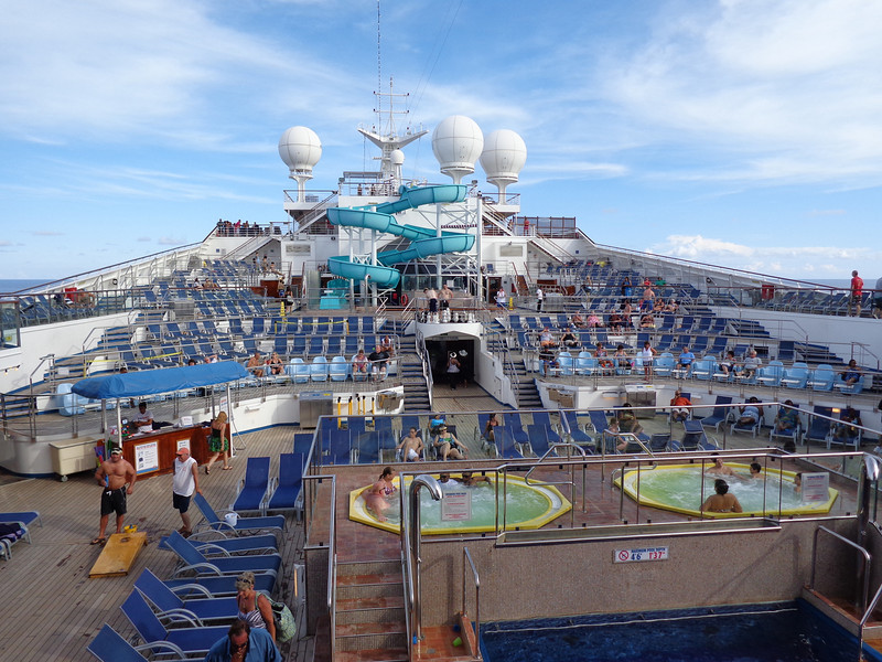 "Well, after enjoying a few days hanging in Fort Lauderdale we made our way onto the ""Carnival Freedom""... there's the main pool area where people enjoyed the sun & partying while we made our way to/from the Caribbean."