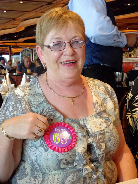As mentioned, the big highlight of our Cruise was celebrating Shawn's Mom's 65th birthday with her... there she is enjoying her big day! :-)