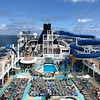 """Speaking of Pool, on """"Bliss"""" like on all Cruise ships it's a popular place with it's multiple pools, multiple hot tubs and very cool slides!<br /> <br /> Well, there you go, a peek at """"Norwegian Bliss"""", Norwegian's newest ship.<br /> <br /> Any questions let us know or if you're interested in a sailing yourself on this fun ship contact Shawn, he'll be Happy to help you book next sailing! :-)<br /> <br /> FYI, our written review of this sailing can be found here: <a href=""""https://www.nancyandshawnpower.com/norwegian-bliss-review/"""">https://www.nancyandshawnpower.com/norwegian-bliss-review/</a>"""