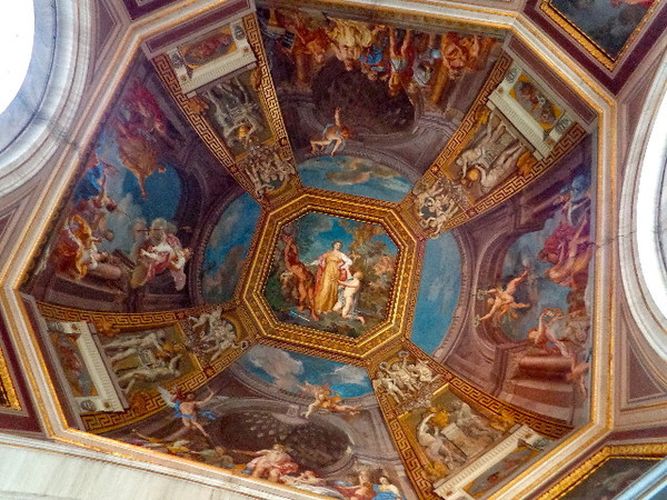Unfortunately you're not allowed to take pictures in the Sistine Chapel but here's another area in the museum where the ceiling artwork gives you a tiny taste of what to expect once in the infamous chapel.