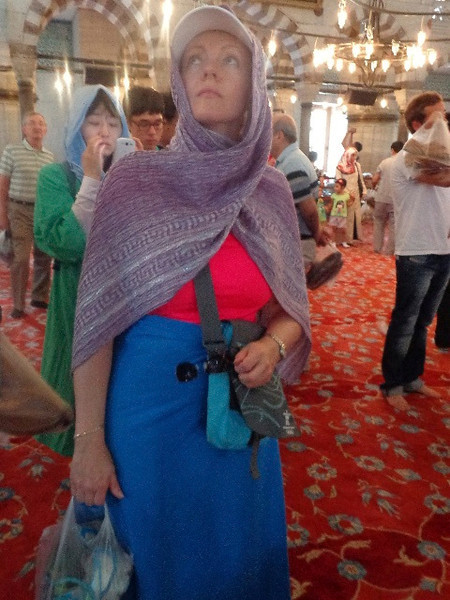 There's Nancy in the Blue Mosque being respectful by covering up like the local ladies do when praying there. No worries if you show up with skin showing, they provide the garments to cover you up.