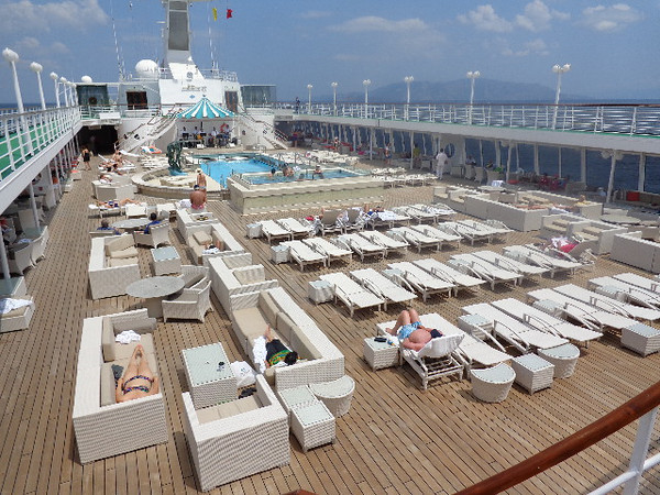 Now if you like perfect weather but you'd rather relax then be active, then the Pool area is where you'll want to be. :-) See the Crystal difference compared to a big-ship... no crowds at the pool so easy to get a spot and super nice loungers & couches to hang out in... for privacy & comfort like this on big-ships, if they even have an area like it (not all ships do) you always have to pay a hefty charge for these luxuries!