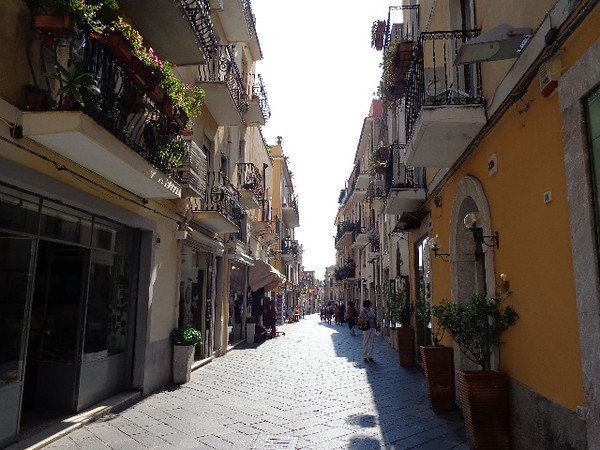 "For our 2nd port stop we pulled into gorgeous ""Taormina"" in Sicily, Italy. Again, there's those charming Italian walkways... Beautiful! :-) As we were there in 2010 we won't show many pictures here but check out Cruise # 21 in our Gallery to see more of this cute little town."