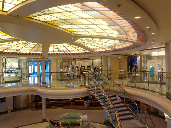 There's a look at a few of the shops that surround the atrium on deck 6 where you can get some great jewelry, clothes, souvenirs, toiletries, etc.  And all duty-free of course! :-)
