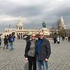 "And then we took in the views from iconic ""Fisherman's Bastion"" which overlooks the city… we were treated to the best views in the city by going up to the upper walkway in the background behind us. <br /> <br /> FYI, when here with another company last year we were shown pictures of the inside of the church and told how beautiful it was and we'd have to pay to get in and then we were pointed to where to buy tickets to go up to the upper walkway for the great views… and then, we were given 3.5 hrs on our own to do those things & buy our own lunch.<br /> <br /> Tauck not only brought us in the church and to the viewpoint but included a fabulous 3 course lunch. After all that we had an hour on our own to shop and explore, much better then 3.5 hrs to figure it out on our own. So yes, Tauck charges a lot more than many of the other companies but are MUCH more inclusive and plan their days much better so you see as much of the important things as possible.<br /> <br /> Tauck even pays for the little things like bathroom breaks at all the places that charge to use their toilets, a frustrating thing that many Americans experience during their trips in Europe."