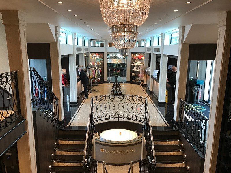 """There's a look at the heart of Tauck's """"Joy"""" ship, her beautiful atrium… that's your meeting point for tours each day and where the boutique is, the reception desk, Tauck's """"Cruise Director's"""" desk, the entrance to the lounge, etc. <br /> <br /> Very elegant isn't it!! :-)"""