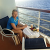 There's Nancy enjoying a pre-dinner drink & appetizer on our Balcony while anticipating another Beautiful Sunset... ahhh, to be at Sea, there's nothing better!! :-)