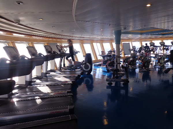 There's a peek at the Gym onboard Disney Magic which features lots of cardio machines, weights & group classes... and did we mention, it's another Adult's Only area! :-)