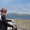 "For our 1st visit to SF a few years back we did their famous boat tour out to the Golden Gate Bridge/Alcatraz, etc. so we figured this time around we'd ""Bike the Bridge""... there's Nancy checking out a great view of Alcatraz we saw on our way to the bridge."