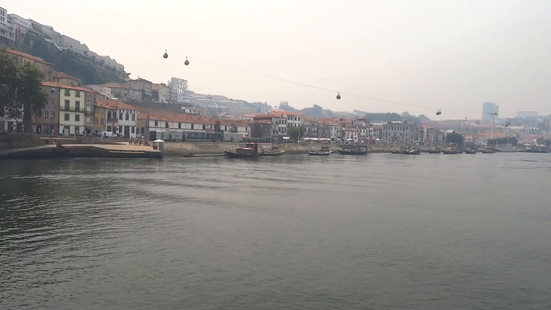 Here's a short video of some more scenes of beautiful Porto, Portugal as we sailed back into town.<br /> <br /> FYI, it's not hazy there due to pollution (the week before the air there was perfect)... unfortunately it was so hot the few days before that there were forrest fires all over Portugal and the smoke made it's way into town.