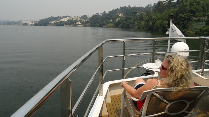 "There's Nancy taking in the scenery at the very front of the boat where we enjoyed lunch one day.<br /> <br /> Well, there you have it... a look at our ""Douro"" River Cruise in Portugal & Spain. As we said, for sure one of the most scenic areas you'll ever sail in Europe and great sites & people too so make sure this unique River Cruise makes it onto your bucket-list! :-)<br /> <br /> Want to check out our more in depth review of this sailing? If so then visit here: <a href=""http://www.nancyandshawnpower.com/douro-river-cruise-review-portugal-spain/"">http://www.nancyandshawnpower.com/douro-river-cruise-review-portugal-spain/</a>"