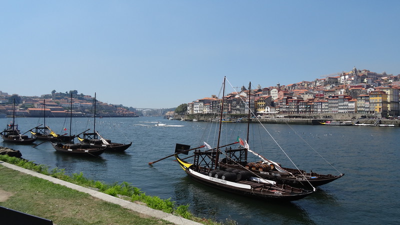 """Vila Nova de Gaia"" is where many of the country's famous Port Wine producers have their warehouses & tasting rooms... those boats are an example of how this famous wine was transported on the Douro years ago before modern technology came along."