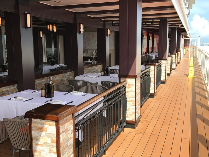 """There's a peek at """"The Waterfront"""" where many of the restaurants onboard feature outside seating."""