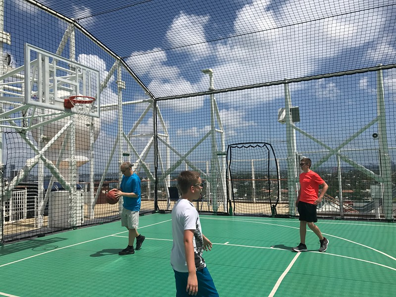"As mentioned earlier, there's something for everyone onboard ""Escape""... especially for those who like to be active... like the Sports Court Shawn enjoyed with his Nephews above where you can play Basketball, Soccer, etc."