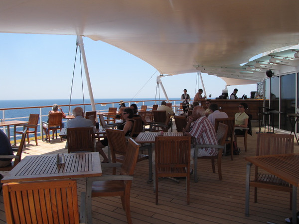 "The ""Sunset Bar"", out the back door of the Buffett area on Deck 11, is a great place to enjoy Breakfast, Lunch, Dinner, a snack/drink, etc while watching the Ocean glide on by... Beautiful!!  And it's called the ""Sunset"" bar for good reason... make sure to experience one out here!!"