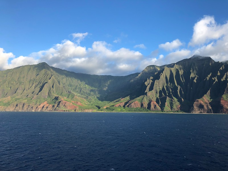 "As we mentioned in the last video, if in budget get yourself a balcony so you can enjoy scenes like this & the next pic (these gorgeous sites are from the ""Na Pali Coast"" which is a big highlight you'll experience during your sailing!) from your room so you won't have to hang out on the top decks & ""jockey"" for space (to get good views/take pictures, etc.) with the 100s of guests without balcony rooms who'll be up there to see the sites."
