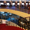"Alright, for those of you not in a Suite who won't be eating in ""Cagney's"", no worries, there's LOTS of places to enjoy yummy food when onboard! :-)<br /> <br /> Here's a look at the 2 ""Main"" restaurants... the upper level is the ""Liberty"" dining room (which has a great ""America"" theme with ""Stars & Stripes"" carpet & chairs & pictures of past Presidents adorning the walls) and the lower level is the ""Skyline"" dining room which is a very cool New York theme!<br /> <br /> FYI, if you want to avoid the buffet & want to experience a nice meal where you order ""A-la-Carte"", this restaurant serves breakfast every morning & dinner each evening."