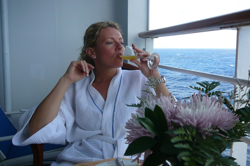 There's Nancy enjoying a little Champagne and OJ and the start of another great day at Sea!!