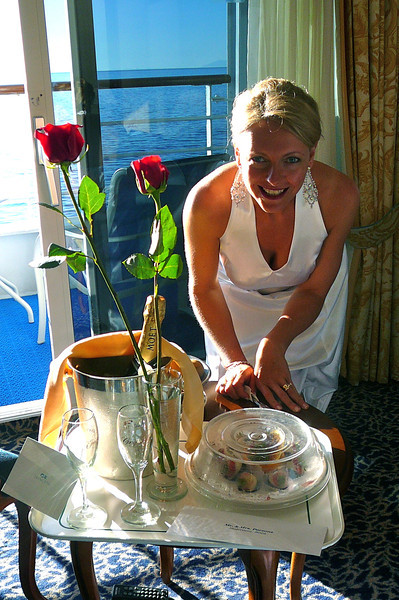 "There's Nancy checking out our ""Honeymoon Package"" that we received when we got to our room. Thanks everyone who gave us onboard ""Cruise Credits"" as a Wedding gift!! We enjoyed this and lots of other goodies!! :-)"