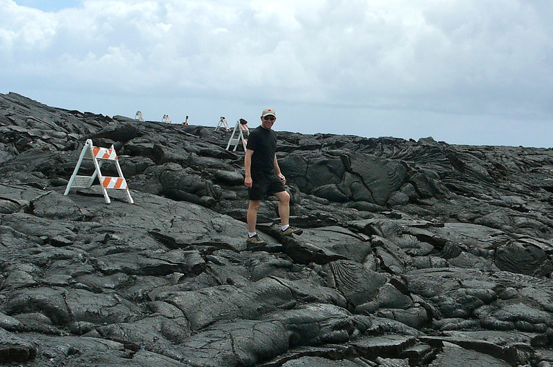 "Hilo's famous attraction is their ""Volcanoes National Park""... there's Shawn doing some close up exploring of Volcanic rock that formed during an eruption on the Big Island."