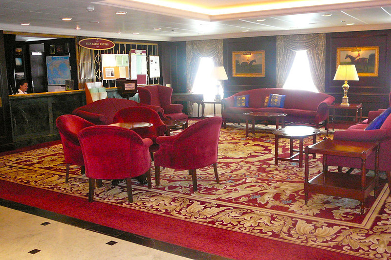 """On our """"Sea Day"""" during day # 4 we figured it was a great time to show you around the Beautiful """"Pacific Princess"""". Here's the quiet sitting area down by the Shore Excursion and Purser's Desk."""