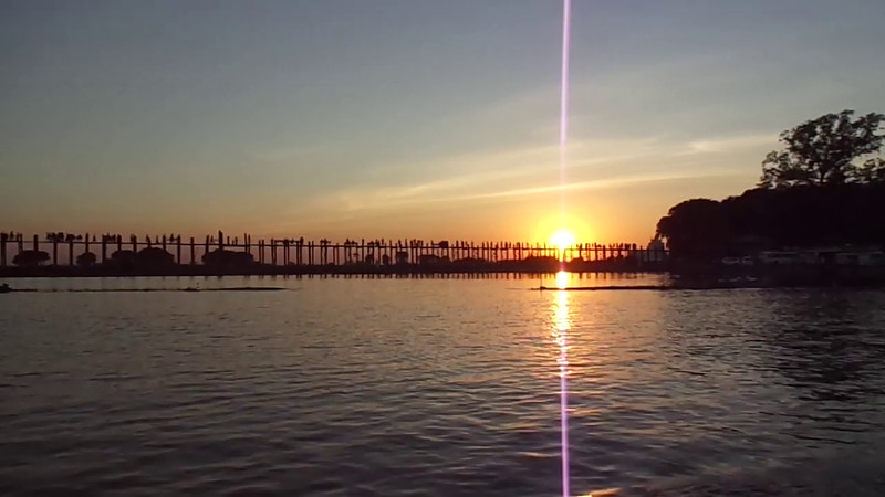 "After exploring by Horse Carriage ride, we moved on to a boat ride which purposefully got us at the perfect angle to see the sunset as it passed behind the magnificent ""U-Bein Bridge"" in Amarapura... check out this video of our fabulous experience!! :-)"
