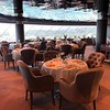"""Another area you'll DEFINITELY enjoy in the """"Yacht Club"""" is the Private Restaurant you'll have access to on Deck 18!!<br /> <br /> As you can see above the views from here are great but even better is all the yummy food we enjoyed in there (it's open for Breakfast, Lunch & Dinner) and even more then that the VERY attentive & friendly service!!<br /> <br /> It's like going to a smaller/speciality Restaurant onboard a big ship but without the hefty charge.<br /> <br /> Normally we go to ALL the specialty restaurants when we sail on big ships but as the food & service were so good here we ended up eating here 5 of the 7 nights we were onboard... we cancelled 3 of our specialty restaurant reservations to eat here instead... we definitely liked it here! :-)"""