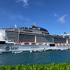 "There's ""MSC Meraviglia"" which was our home for a week as we sailed around the Caribbean... with 4,500 guests onboard (over 5,000 when you count the rooms with 3 or 4 in the room) it's one of the biggest ships we've ever sailed on... and it was BUSY!!<br /> <br /> We still loved our experience onboard since we stayed in a ""Yacht Club' Suite (we'll explain more about that shortly) but all for that we don't think we would have enjoyed as the areas outside of the Yacht Club (restaurants, bars, pools, etc.) were constantly packed and it seemed like this ship had more kids onboard (and they let them in the clubs till late at night?) then any we've been on so it was noisy... except when we went to our  quiet, exclusive, heavenly-like Yacht Club area which was the perfect refuge from the madness!! :-)<br /> <br /> Some things to keep in mind... you HAVE to be open to an International crowd if you sail on MSC Cruises... MAYBE 20% of the people onboard were North Americans and spoke good English... don't get us wrong, everyone was nice but many times we'd try to talk to others in the elevator, etc. only to learn they didn't speak good English so we had a tough time communicating with each other!<br /> <br /> EVERY-TIME an announcement was made (which means the announcements onboard are REALLY long!!) it was done in English, Italian, Spanish, German, Portuguese and French so that gives you a good idea of just how ""International"" the passengers onboard are!!"