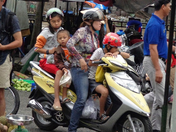 We told you earlier about the millions of motorbikes in Vietnam but we probably didn't mention how many people they put on them... there's a typical family of 4 traveling around on one... makes you wonder why the mini-van ever needed to be invented. :-)