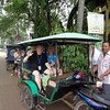 "Earlier you saw us doing a Cyclo/Rickshaw ride in Phnom Penh. Another popular way to get around in Cambodia is by ""Tuk Tuk""  which is their version of taxis... except here, you can get around anywhere in a town like Siem Reap for $2-3 which is the cost to just step in a taxi back home. :-)<br /> <br /> Here we are enjoying a tour of Siem Reap by Tuk Tuk as well as a visit to a stone & wood carving establishment."