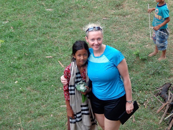 "There's Nancy enjoying some time with ""Lina"", one of the local girls who walked with us through the Village & practiced her English, told us about her family & school, etc.  She was so sweet! :-)"