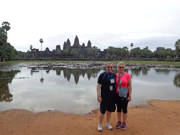 """There we are posing just outside Cambodia's most recognized symbol, """"Angkor Wat""""... for sure a place you'll want to get on your Bucket List as its pretty spectacular to visit!<br /> <br /> To learn more about Angkor Wat visit here: <a href=""""http://nancyandshawnpower.com/angkor-wat-mekong-river-cruise/"""">http://nancyandshawnpower.com/angkor-wat-mekong-river-cruise/</a>"""