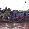 """Here's something very cool you don't see at home... click play to see what a Vietnamese """"Floating Market"""" looks like."""