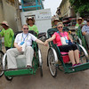 "Have you ever done a Cyclo/Rickshaw ride before?  If not, you will when in Vietnam & Cambodia.<br /> <br /> Here's us posing before our 1st one in Cambodia's Capital City, ""Phnom Penh"", and we also did one in Hanoi... it's a great way to get up close to the heart of a city & for sure lots of fun! :-)"