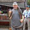 "When we hopped off in ""Cai Be"" to visit a Rice factory Shawn couldn't pass up the opportunity to hold a very big (over 50lbs) ""Boa"" snake... Nancy wasn't haven't it though, behind the camera worked well for her! :-)"