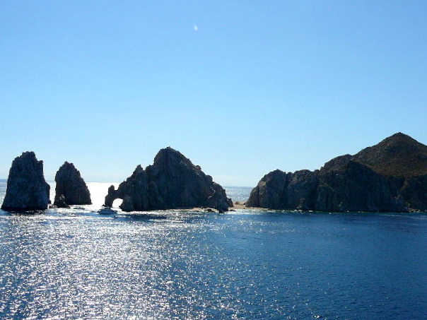 "There's a glimpse of some of Cabo's famous rock formations including ""Los Arcos""."
