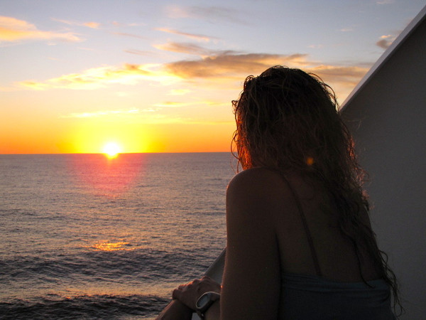 There's Nancy enjoying one last Gorgeous Pacific Ocean Sunset from our room... we did tell you buying yourself a Stateroom or Suite with a Private Balcony is well worth it, didn't we? :-)