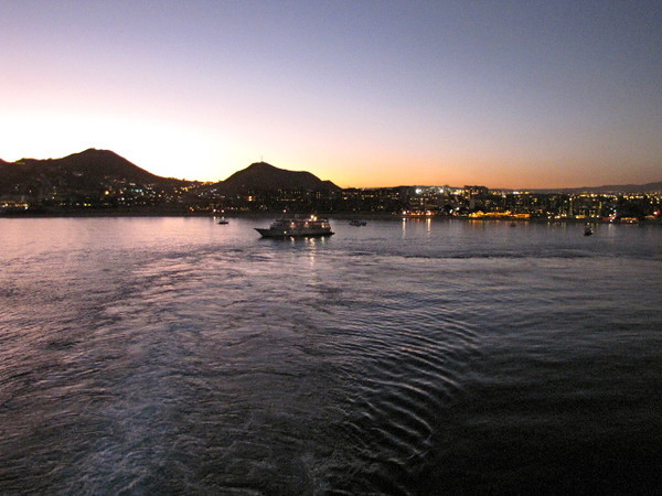 "As we sailed away after spending the day in ""Cabo San Lucas"" we were treated to an amazing Sunset and this Gorgeous view from our Private Balcony in our Stateroom... now that's nice!! :-)"