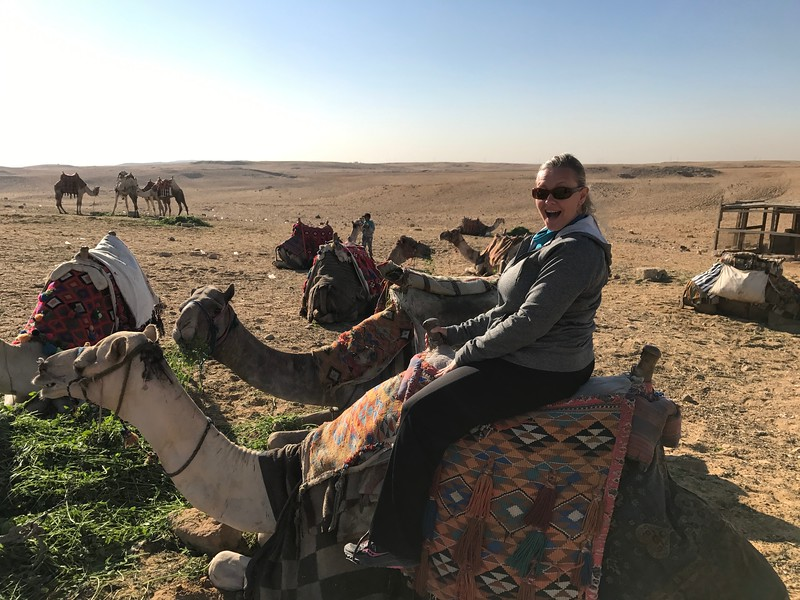 """As they say, """"When in Rome"""", so for sure we had to ride a camel in the Sahara desert... looks like Nancy is excited to be trying out a very unique form of transportation!! :-)"""
