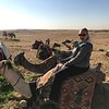 "As they say, ""When in Rome"", so for sure we had to ride a camel in the Sahara desert... looks like Nancy is excited to be trying out a very unique form of transportation!! :-)"