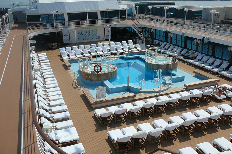 "We managed to snap a pic of the ""Journey's"" Pool Deck before all the Sun bathers got on. :-) Check out the cushy White loungers... very inviting! That's an example of the differences you'll find on an ""Upper Premium"" Cruiseline like Azamara compared to a Big Ship/Mainstream Line."