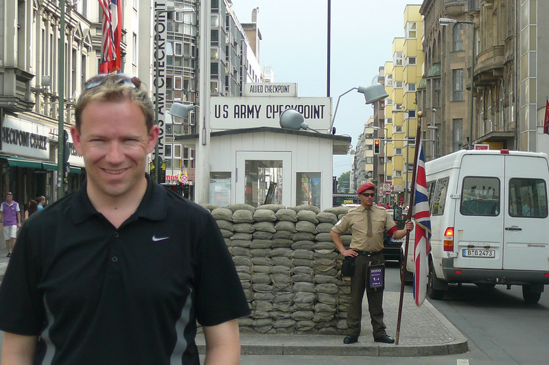 "Shawn posing at the Famous ""Checkpoint Charlie"" landmark."